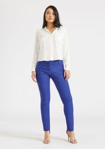 Madison modeling the Gianna Dressy Skinny Pant in Royal Blue
