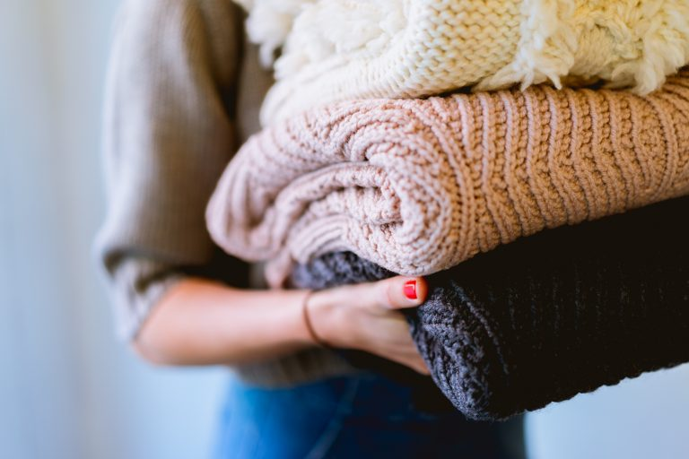 Fall and winter fashion means sweaters and layering up.